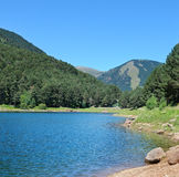Lake, mountains and blue sky Stock Photography