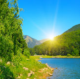 Lake, mountains and blue sky Royalty Free Stock Photos