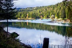 Lake in the mountains Caumasee in Switzerland in Flims Laax with reflections on the water stock images