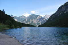 Lake in the mountains. Driving through Austria we stopped at this amazing crystal blue lake in the mountains Royalty Free Stock Photos