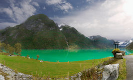 Lake in Mountains. Emerald green colour lake and mountains in valley. Norway Royalty Free Stock Image