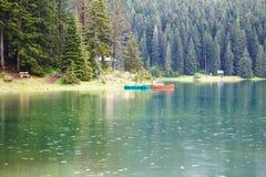 Lake in mountains with fog nea Stock Photos