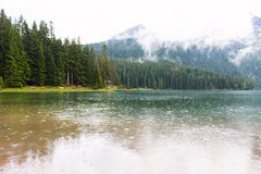 Lake in mountains with fog near Budva Royalty Free Stock Photography