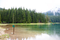 Lake in mountains with fog near Stock Photography