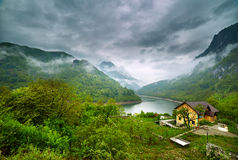 Lake in the mountains on a foggy day Stock Image