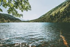 Lake in mountains with forest Landscape Stock Photos