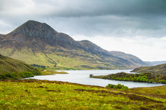 Lake and Mountains in Isle of Skye island. Landscape in Highland Stock Images