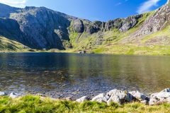 Lake and mountains, Llyn Idwal and the Devil's Kitchen. Stock Photo