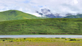 Lake, mountains and  meadow Stock Photo