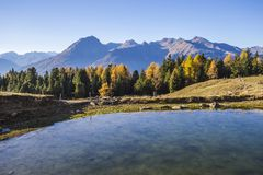 Autumn landscape in Valtellina in Italy. Lake in the mountains of Mortirolo in Valtellina, Italy Stock Photos