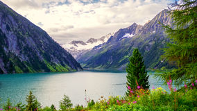 Lake and mountains. Lake and mountain at cloudy weather in Alps Royalty Free Stock Photography