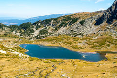 Lake in the mountains. Mountain lake in the glacial period in the mountains of Bulgaria Royalty Free Stock Image
