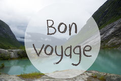 Lake With Mountains, Norway, Bon Voyage Means Good Trip. French Text Bon Voyage Means Good Trip. Lake With Mountains In Norway. Cloudy Sky. Peaceful Scenery Stock Photography