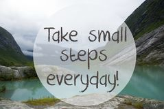 Lake With Mountains, Norway, Quote Take Small Steps Everyday. English Quote Take Small Steps Everyday. Lake With Mountains In Norway. Cloudy Sky. Peaceful royalty free stock image