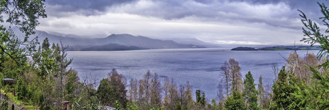 Lake and mountains. Panorama view with trees, lake and mountains Royalty Free Stock Photo