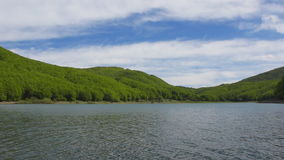 Lake in mountains. Panoramic view of lake in mountains, Italy stock video footage