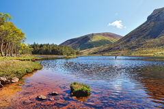 Lake in the mountains of Peninsula in Ireland. Lake in the mountains of the Dingle Peninsula in Ireland stock image