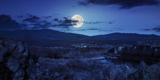 Lake in mountains quarry near city at night Stock Photo