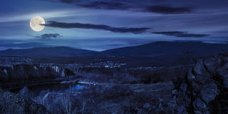 Lake in mountains quarry near city at night Royalty Free Stock Photos