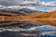 Lake mountains reflection snow clouds autumn Royalty Free Stock Photo