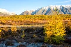 Lake and mountains of Siberia. Lake Baikal and mountains of Siberia with clouds weather, Russia stock image