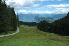 Lake, mountains and ski lift nearby Luzern in Switzerland Royalty Free Stock Photos