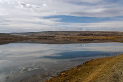 Lake mountains steppe sky clouds Stock Images