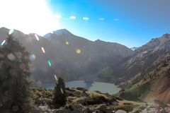 Mountain lake and sunny rays. royalty free stock images
