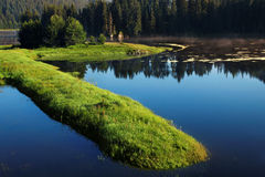 Lake in the mountains. Lake at sunrise in the Rhodope Mountains in Bulgaria royalty free stock photography