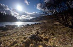 Lake, mountains and sunset Royalty Free Stock Image