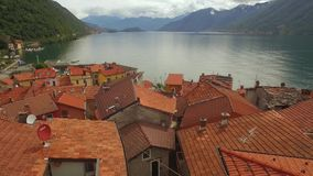 Lake with mountains and towns in Italy stock footage