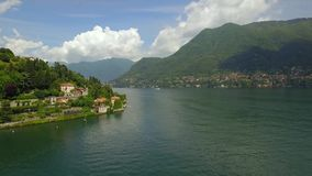 Lake with mountains and towns in Italy. Como lake with mountains and towns in Italy stock footage
