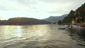 Lake with mountains and towns in Italy. Como lake with mountains and towns in Italy stock video