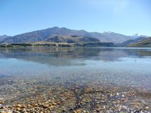 Lake and mountains, translucide water wanaka new zealand royalty free stock photo