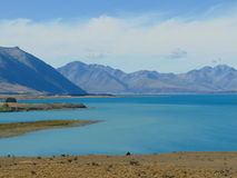 Lake and mountains. Turquoise lake in front of mountains Stock Photography
