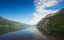 Lake and mountains under blue sky. Walensee. Switzerland. Popular touristic destination Royalty Free Stock Images