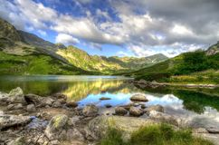 Summer landscape. Lake in mountains. Splendid Five Lakes Valley in Polish Tatra mountains, one of the most beautifully place in the world stock photos
