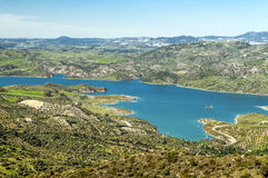 Lake in the mountains of Zahara. De la sierra with some trees olive trees llocated in the Spanish province of Cadiz, on a clear day Stock Photos