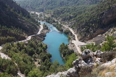 Lake in the mountainside. Arial view of a turquoise lake with a bridge Stock Photography