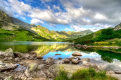 Lake in mountains in the early morning colors. Royalty Free Stock Images