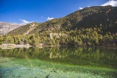Emerald Lake Mricho Tal near Pisang. Himalaya mountains. Nepal, Annapurna circuit trek. Lake Mricho Tal with water of emerald color near Pisang. Himalaya royalty free stock images