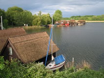 Lake Mueritz. With thatched boathouses in Mecklenburg-Western Pomerania, Germany stock image