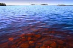 Lake Muskoka. Rocks on the shore of lake muskoka Royalty Free Stock Photos