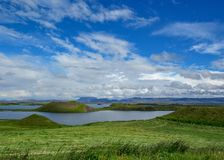 Lake Myvatn with green pseudocraters and islands at Skutustadagigar, Diamond Circle, in North of Iceland, Europe stock images