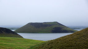Lake Myvatn pseudocrater in the mist. In Iceland stock images