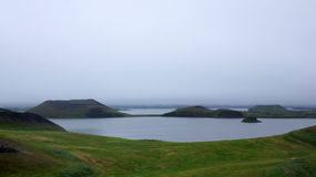 Lake Myvatn pseudocraters in the mist. Lake Myvatn pseudocrater in the mist in Iceland stock images