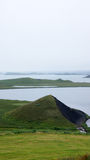 Lake Myvatn triangel hill near pseudocraters. In the mist in Iceland royalty free stock photo