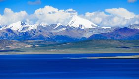 Lake Nam and Snow Mountain. Snow mountain near lake Nam. Lake Nam is the second largest saltwater lake in China stock image