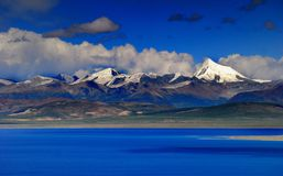 Lake Nam and Snow Mountain Stock Photography