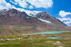 Lake near Barskoon pass in Tien Shan mountains Royalty Free Stock Image